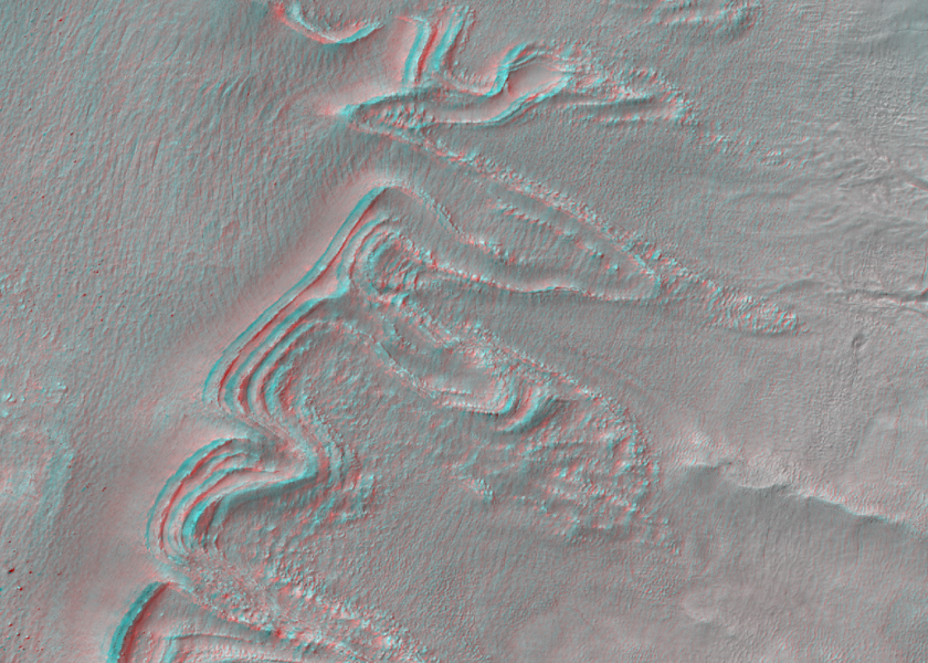 Concentric arcuate ridges at base of crater walls