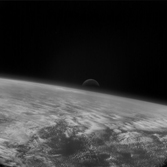 Moonrise over Earth's limb from Rosetta