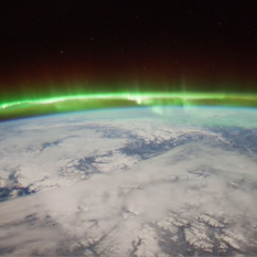 The aurora, an ionospheric phenomenon, seen from space