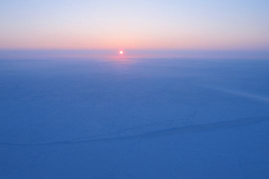 Sunrise over sea ice near the North Pole