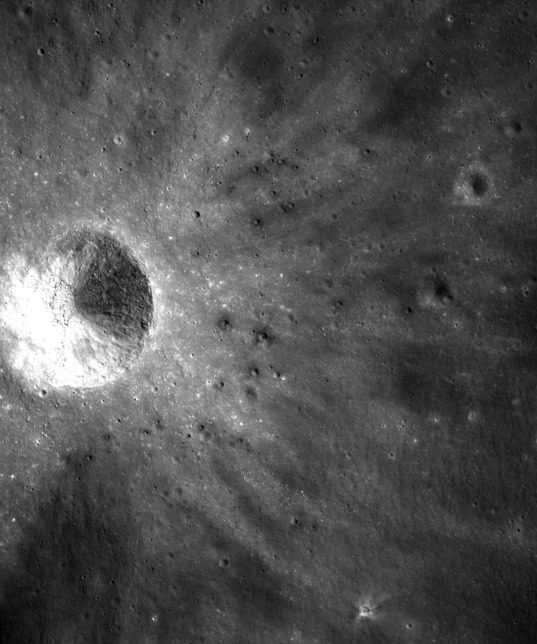 Dark secondary crater cluster on the Moon