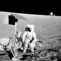 Pete Conrad at the Surveyor 3 spacecraft, with the Apollo 12 Lunar Module in the background