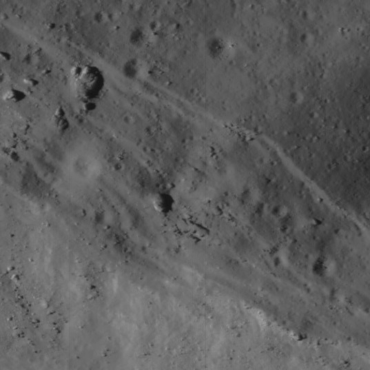 Necho crater detail: tectonic features on crater rim