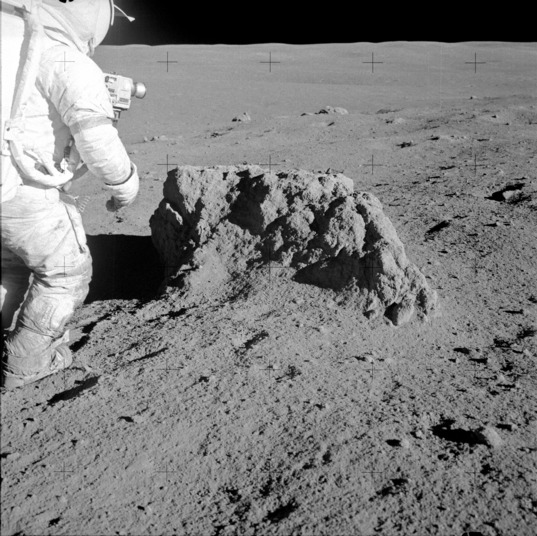 Apollo 14: Alan Shepard checks out a boulder