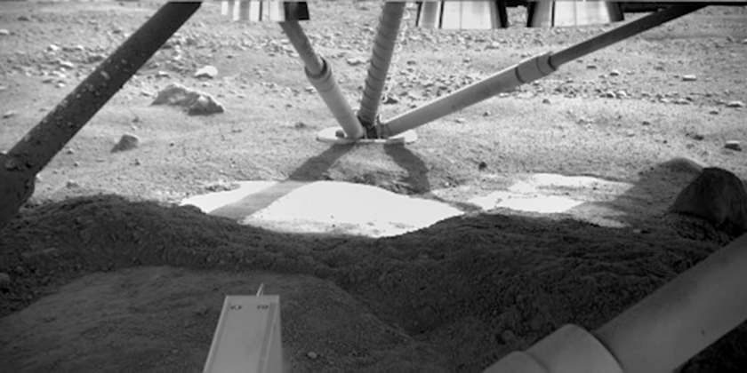 Holy Cow! Ice under the Phoenix lander, sol 5