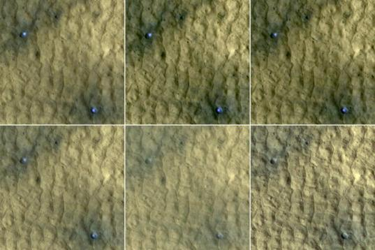 Ice in a pair of fresh craters on Mars fades with time
