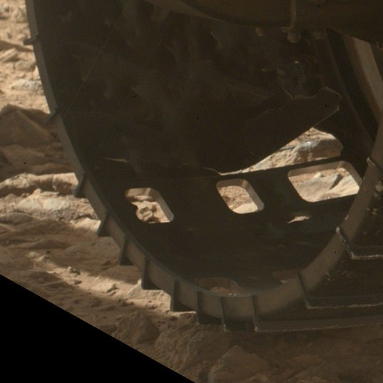 Detail view of Curiosity's left front wheel, sol 463 (November 11, 2013)
