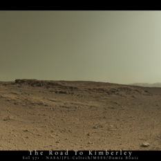 Postcard from Curiosity sol 571: low light over a butte and tracks