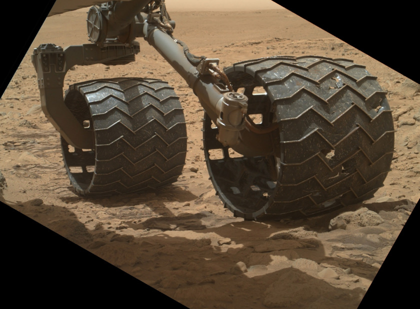 Curiosity's left rear and middle wheel, sol 695 (July 21, 2014)