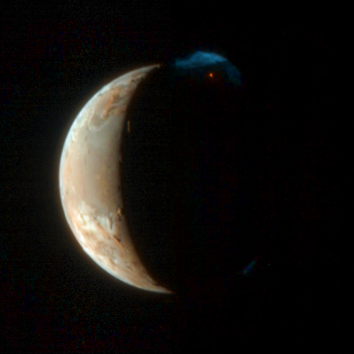 Io erupts, in color
