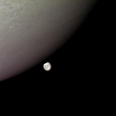 Europa peeks from behind Jupiter