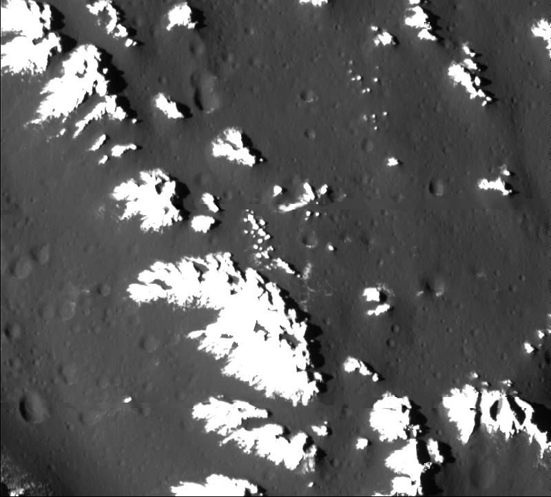 Frost-capped peaks of Asgard's rim, Callisto