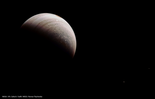 Crescent Jupiter with Europa and Io from Juno