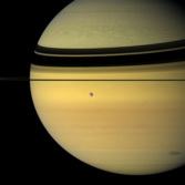 Saturn with Tethys and Mimas' shadow