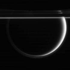 Enceladus, Titan, and the rings of Saturn