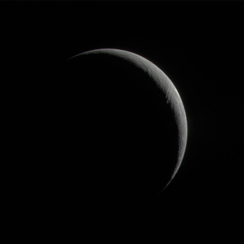 Enceladus' crescent in natural color