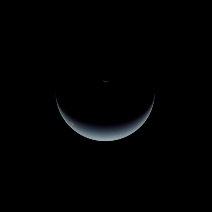 Voyager 2 departing view of Neptune and Triton