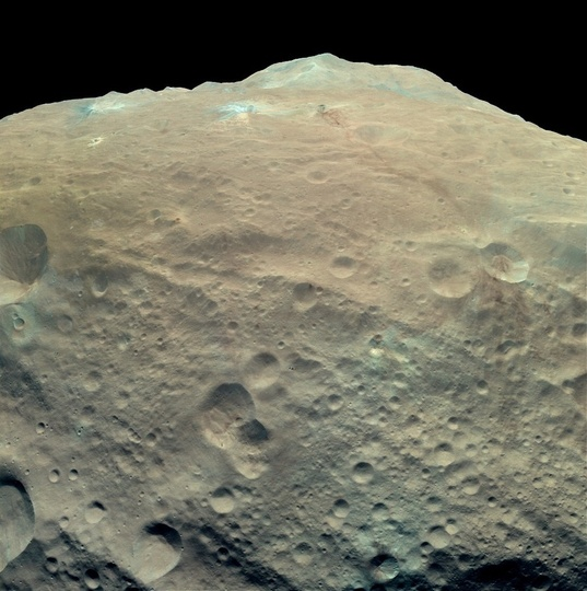 Enhanced-color view of Vesta's southern mountain