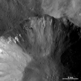 Dark and bright material in a crater wall