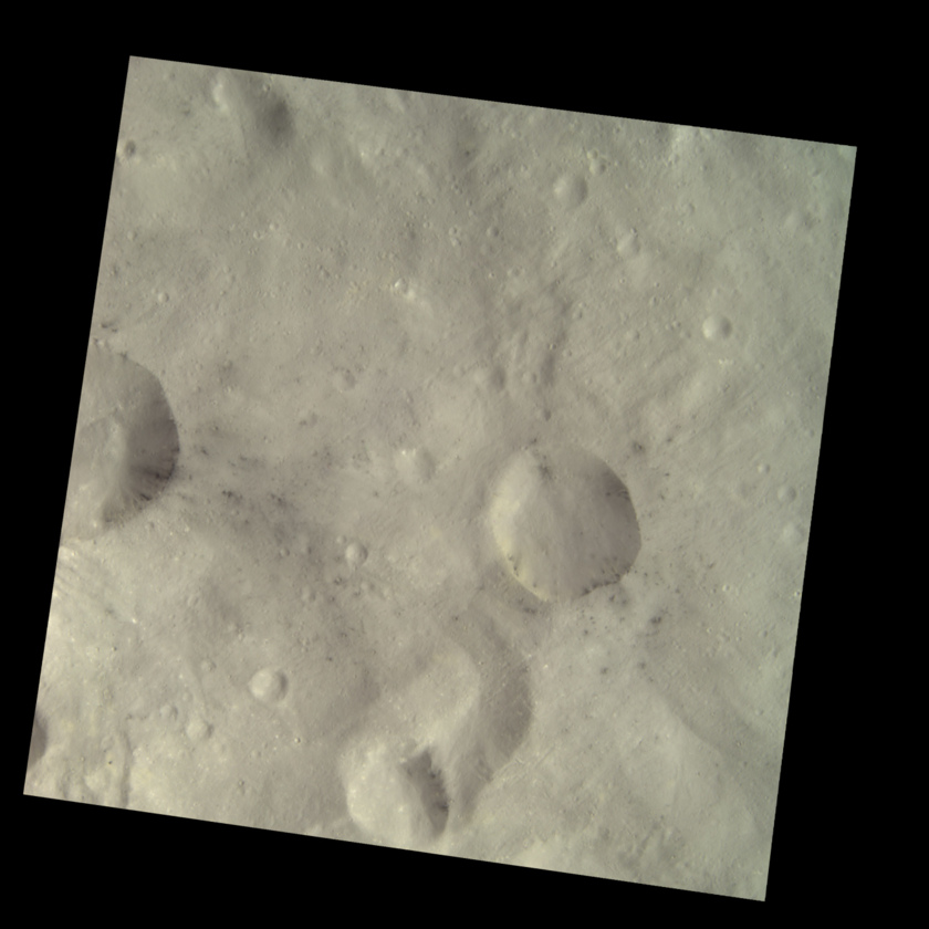 Dark spots on Vesta (HAMO color image)