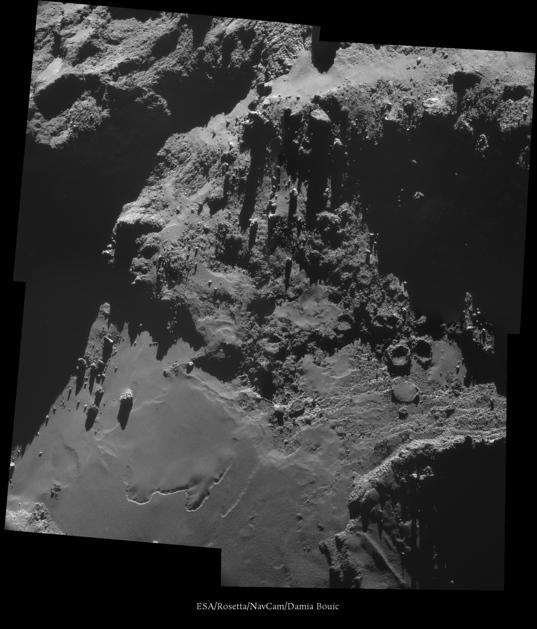Comet Churyumov-Gerasimenko: pits, scarps, and boulders on the neck, October 18, 2014