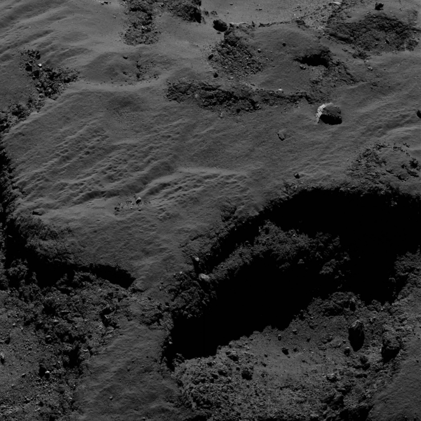 Pitted and fractured terrain with a bright block on comet 67P