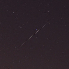 Geminid meteor passing by North Star
