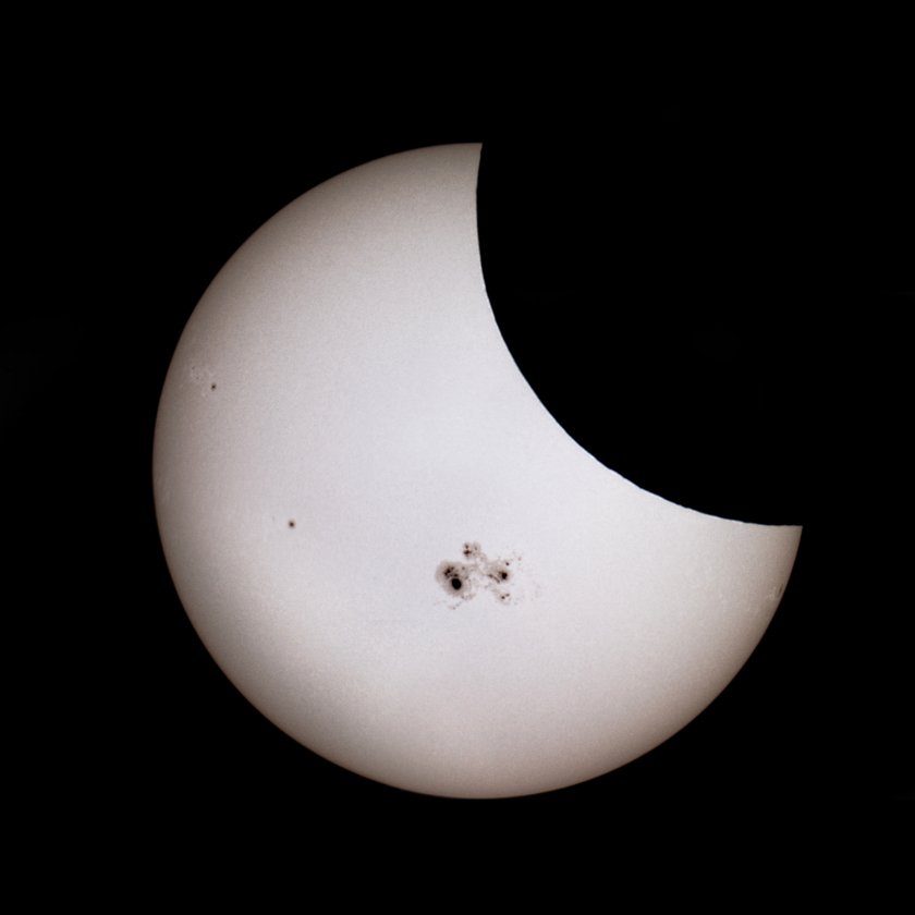 Mid Eclipse with Giant Sunspot