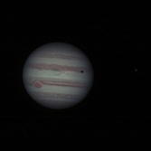 Jupiter with Io casting its shadow