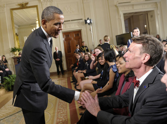 President Obama shakes Bill Nye's hand at the 2012 White House Science Fair
