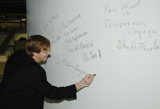 Hal Weaver signs the fairing on the New Horizons rocket