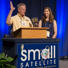 Rex Ridenoure accepts AIAA 2015 Small Satellite Mission of the Year Award on behalf of the LightSail team