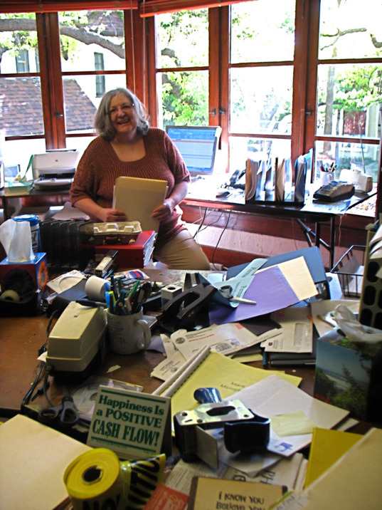 Financial Director Lu Coffing packs up her desk