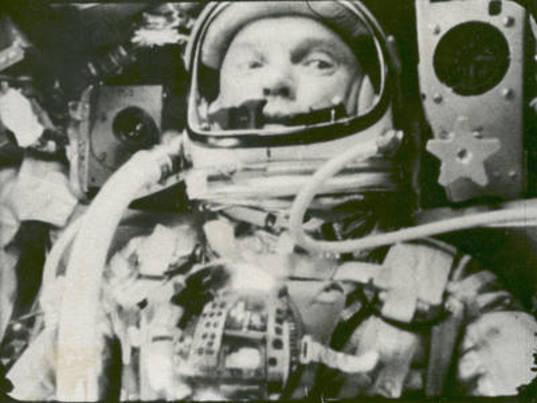 John Glenn in his Friendship 7 capsule orbiting Earth