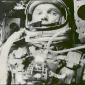 John Glenn in his Friendship 7 capsule orbiting Earth