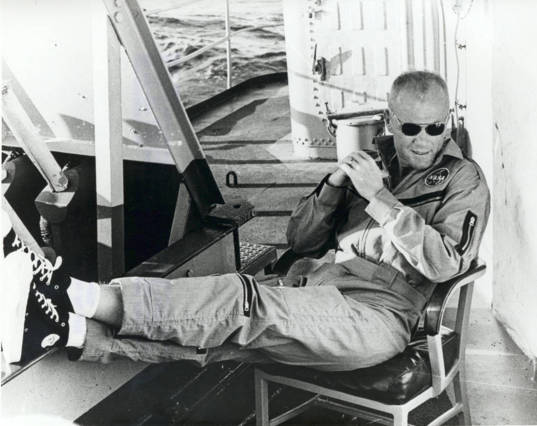 John Glenn relaxes aboard ship after becoming the first American to orbit the Earth