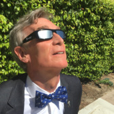 Bill Nye with eclipse glasses