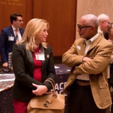 Former NASA Chief Scientist, Dr. Ellen Stofan, speaks with former NASA Administrator Charles Bolden