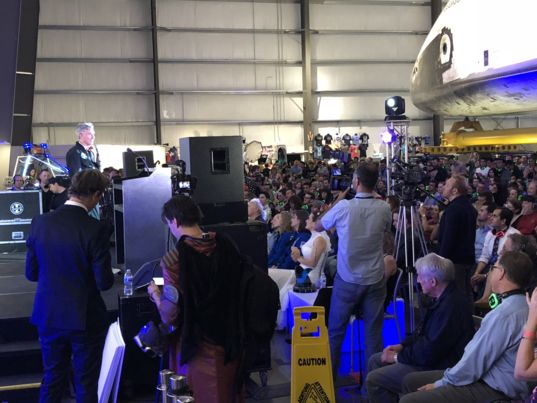 Bill Nye on stage at the 2018 Yuri's Night celebration under Space Shuttle Endeavour