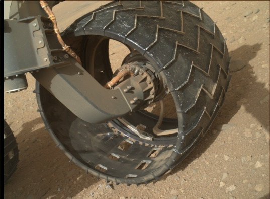 Curiosity's left front wheel, sol 411
