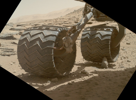 Curiosity wheel perched on a rock, sol 631