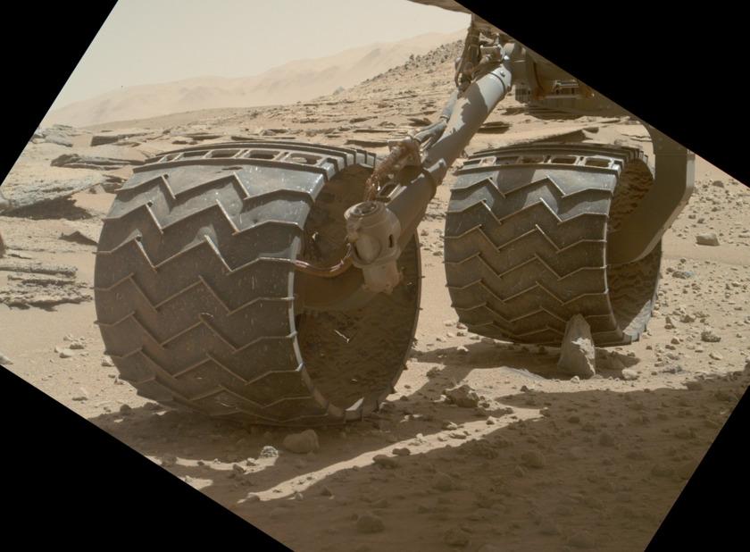 Curiosity wheel perched on a rock, sol 631