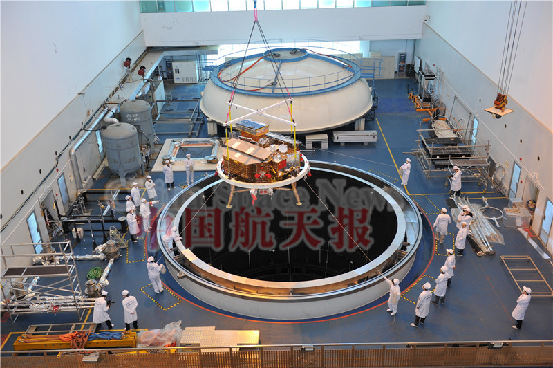 Chang'E 3 being lowered into chamber for thermal vacuum testing, May 2013