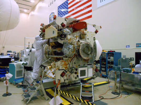 OSIRIS-REx on rotation fixture with SARA installed and SRC opened