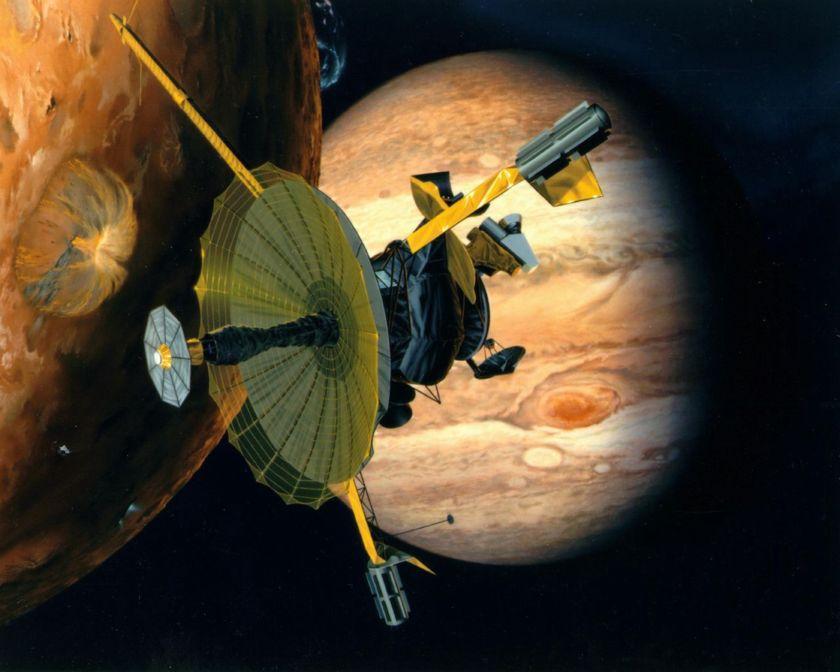 Artist's impression of NASA's Galileo spacecraft flying past Jupiter's volcanically active moon Io
