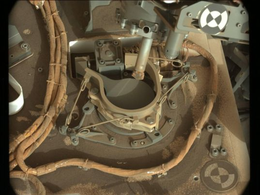 Curiosity's drill poised over the CheMin inlet, sol 2068