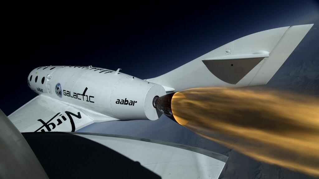 http://planetary.s3.amazonaws.com/assets/images/technology/20130429_spaceshiptwo_powered_flight_boom-camera.jpg