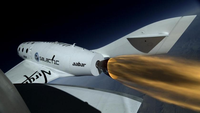 View from SpaceShipTwo of its rocket firing