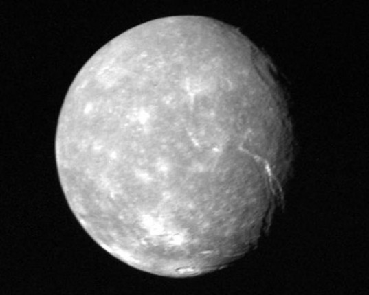 Uranus's moon Titania as seen in low resolution by the Voyager 2 spacecraft in 1986
