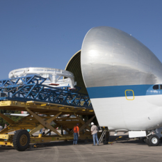 Super Guppy swallows Orion service module testing hardware